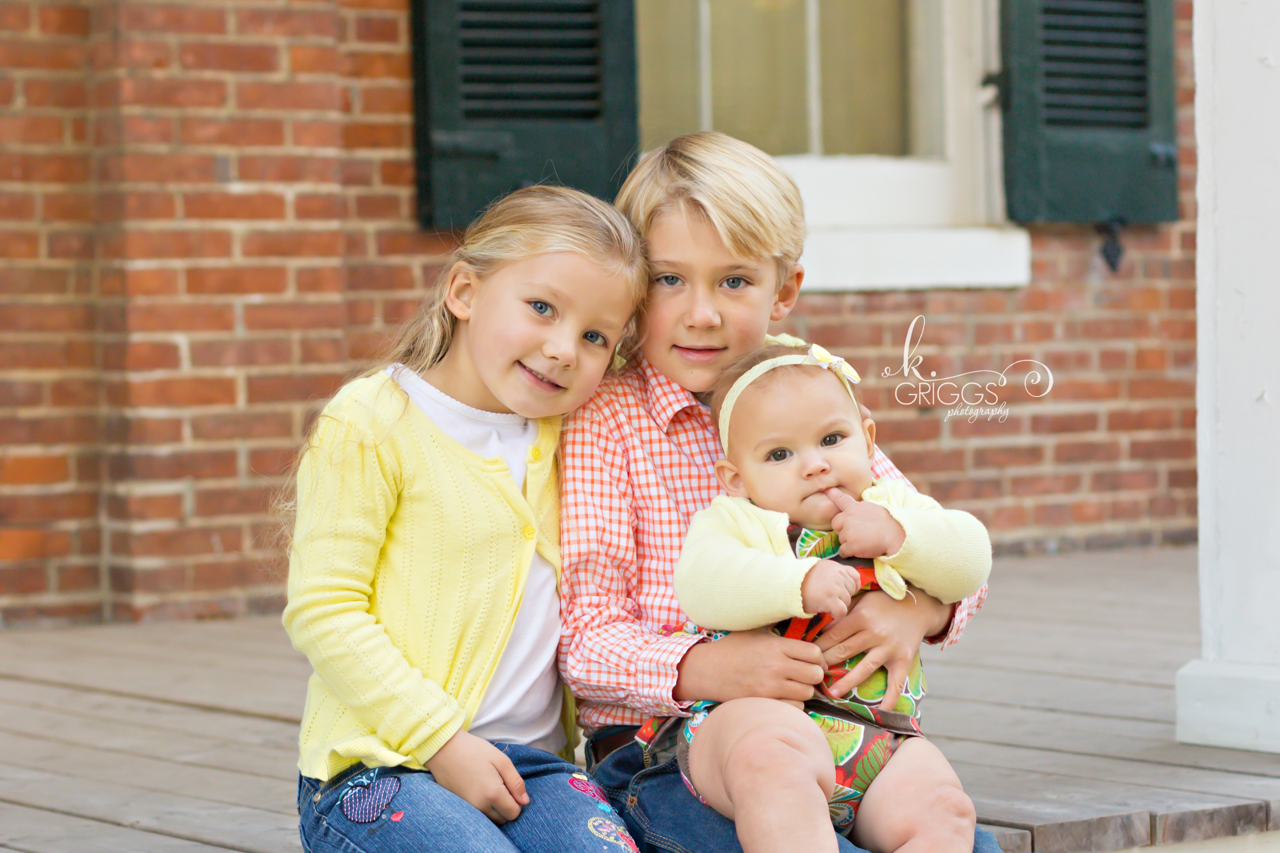 St. Louis Family Photographer - KGriggs Photography - three kiddos sitting on steps - Queeny Park, St. Louis, MO