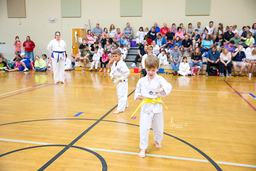young boy performing martial arts | kirkwood family photographer