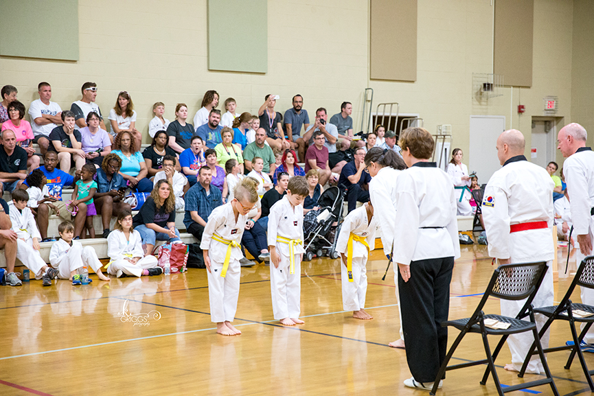 boys bowing to judges at tournament | st louis photography