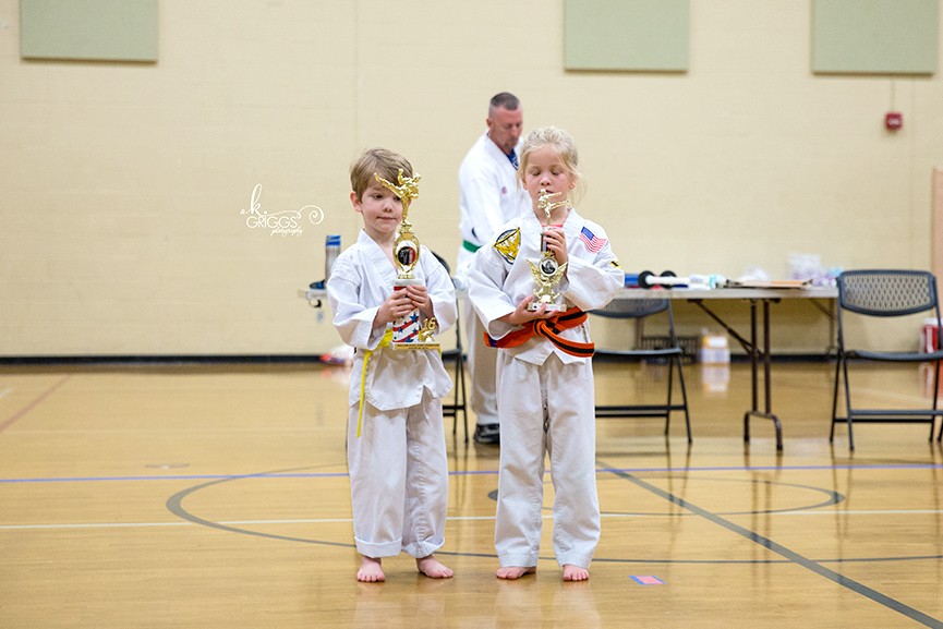 two kids with trophies | kirkwood children's photographer