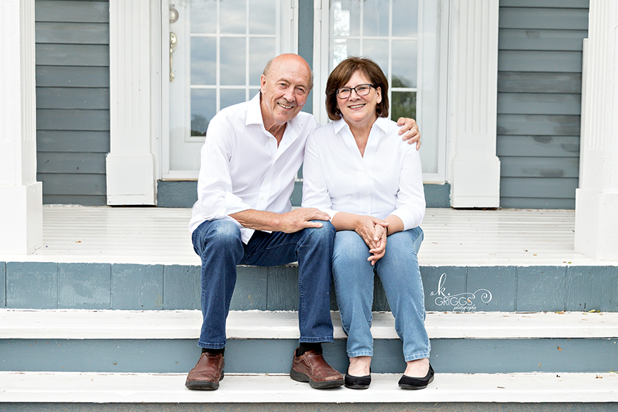 Couple sitting on steps of their house | St. Louis Family Photography