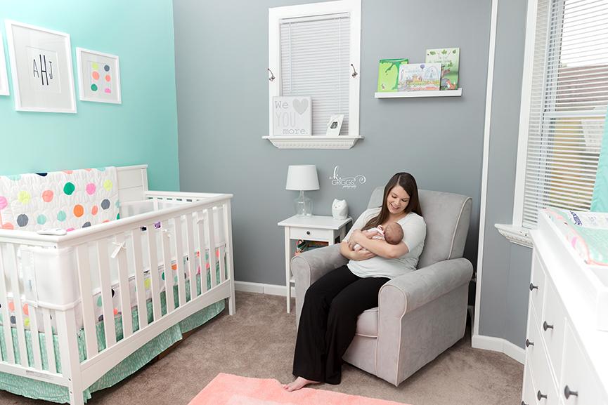 Mom rocking newborn baby in her nursery. | St. Louis Photographer
