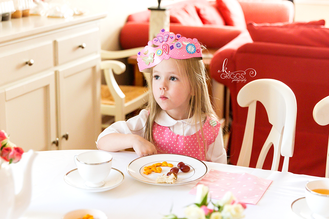 Little girl sitting at table wearing tiara | St. Louis Family Photographer