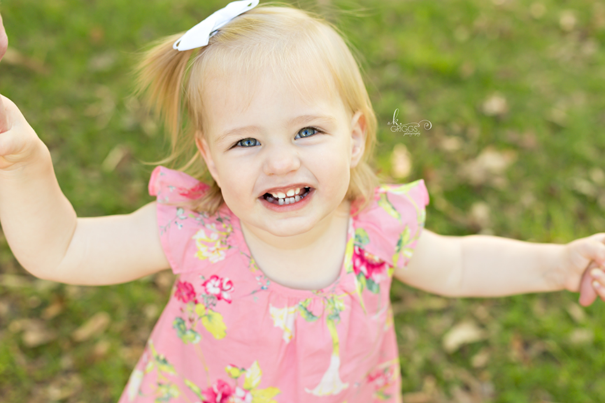 Little girl smiling at camera. | St. Louis Children's Photographer