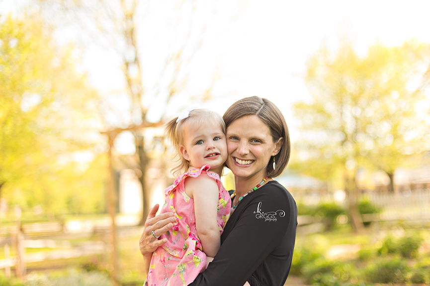 Mom and daughter smiling for camera. | St. Louis Portraits