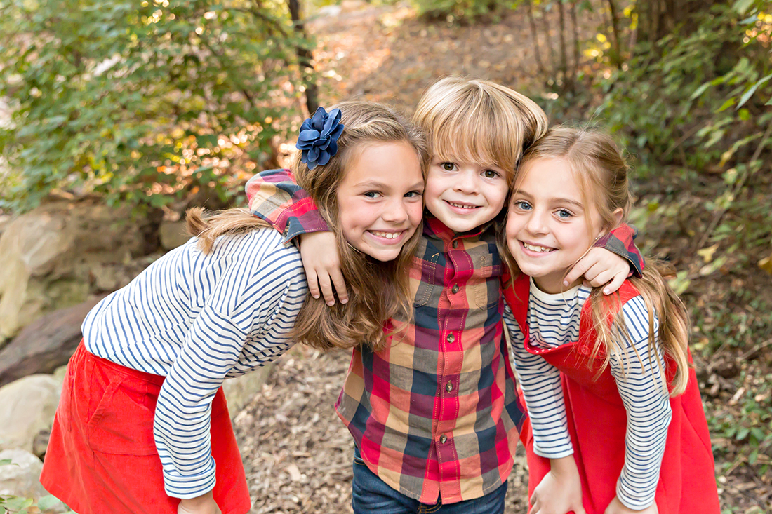 Two sisters and their little brother in Longview Farm Park | St. Louis Family Photographer