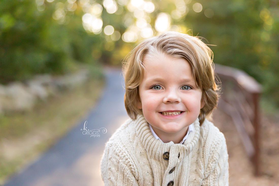 Young boy smiling at camera Longview Farm Park | St. Louis Family Photographer