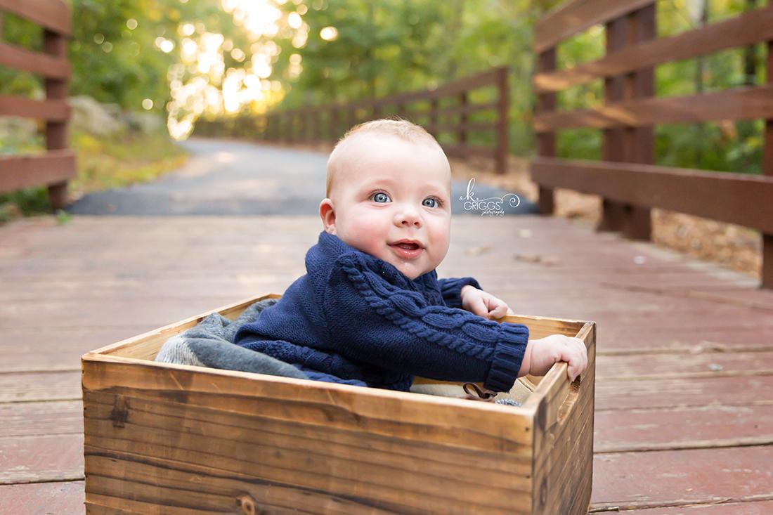 Infant boy sitting in crate Longview Farm Park | St. Louis Family Photographer