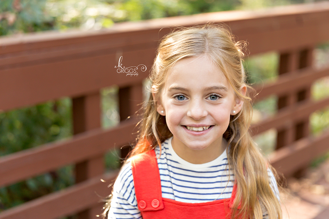Sweet blonde girl smiling at camera Longview Farm Park | St. Louis Photographer