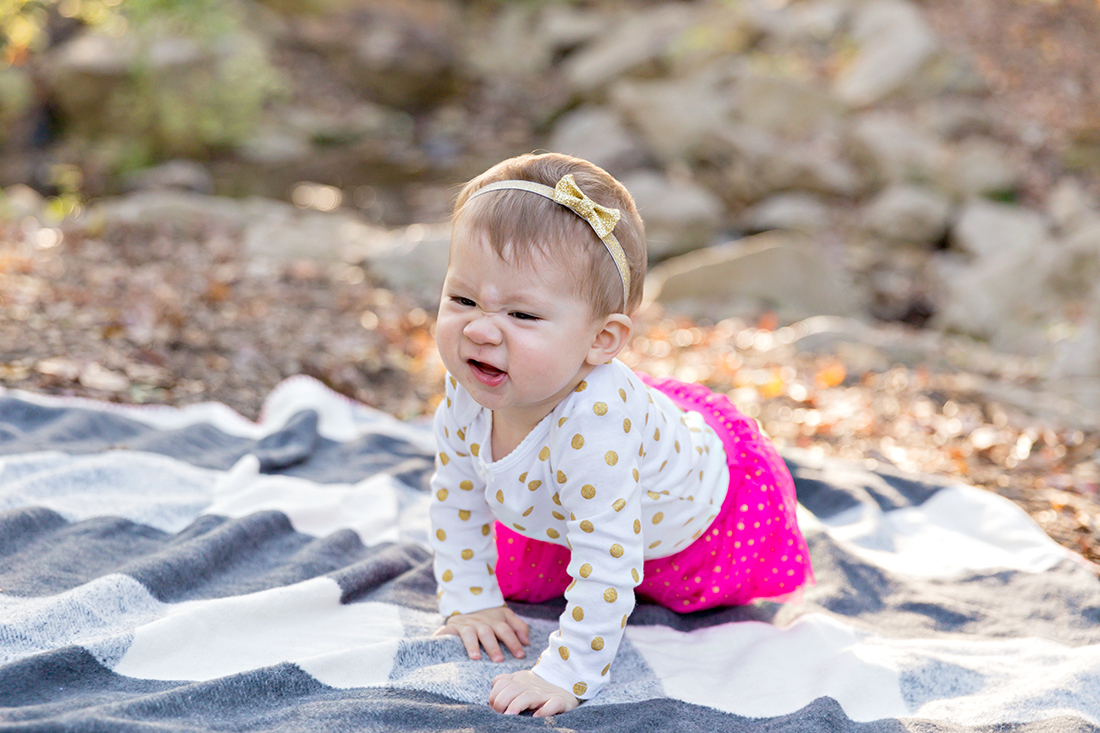 Infant girl making funny face - Longview Farm Park | St. Louis Photography