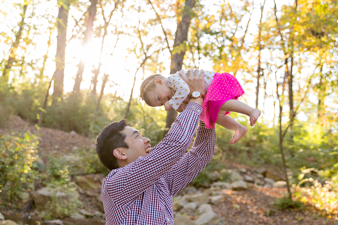 Daddy holding daughter over his head - Longview Farm Park | St. Louis Family Photography