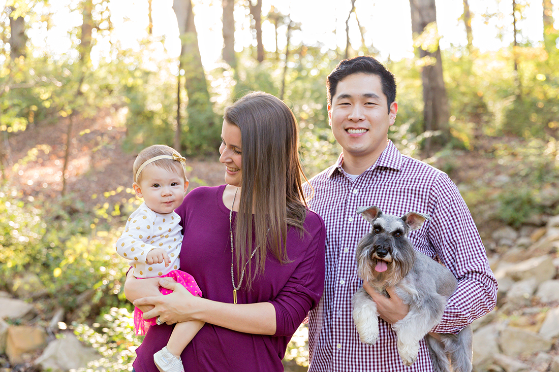 Family of 3 with a dog smiling - Longview Farm Park | St. Louis Photographer