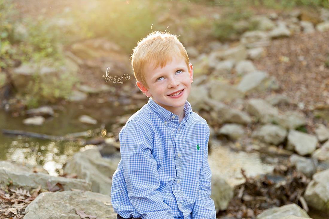 Young boy rolling his eyes Longview Farm Park | St. Louis Photos