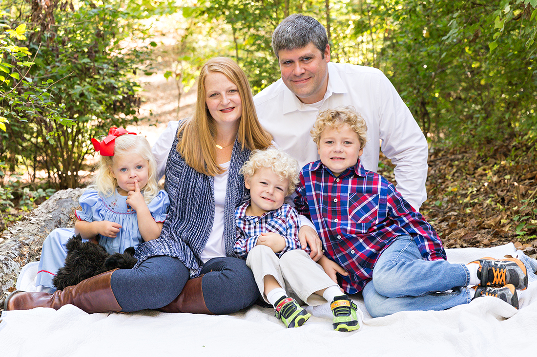 Family of 5 sitting on blanket in wooded area - Longview Farm Park | St. Louis Photographer