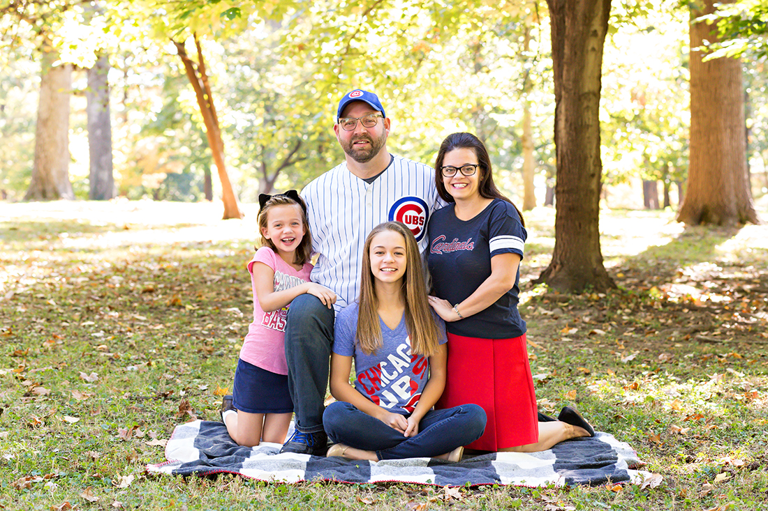 Family of four dressed in sports clothes {St. Louis Photography}