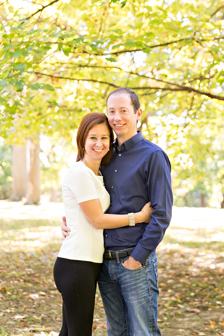 Sweet couple hugging under tree in a park {St. Louis family photographer}