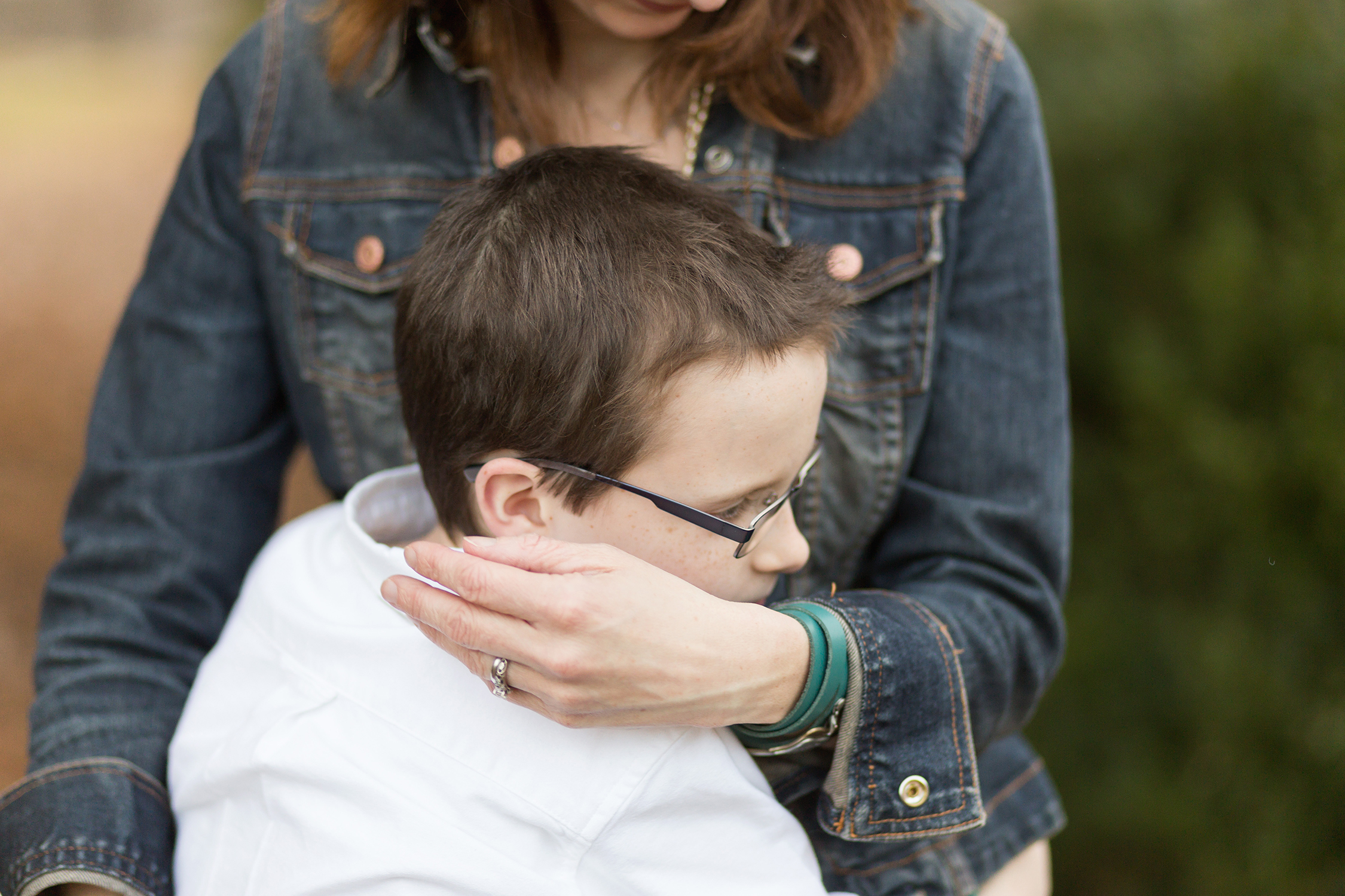 Young boy hugging his mother. | Kirkwood Children's Photography