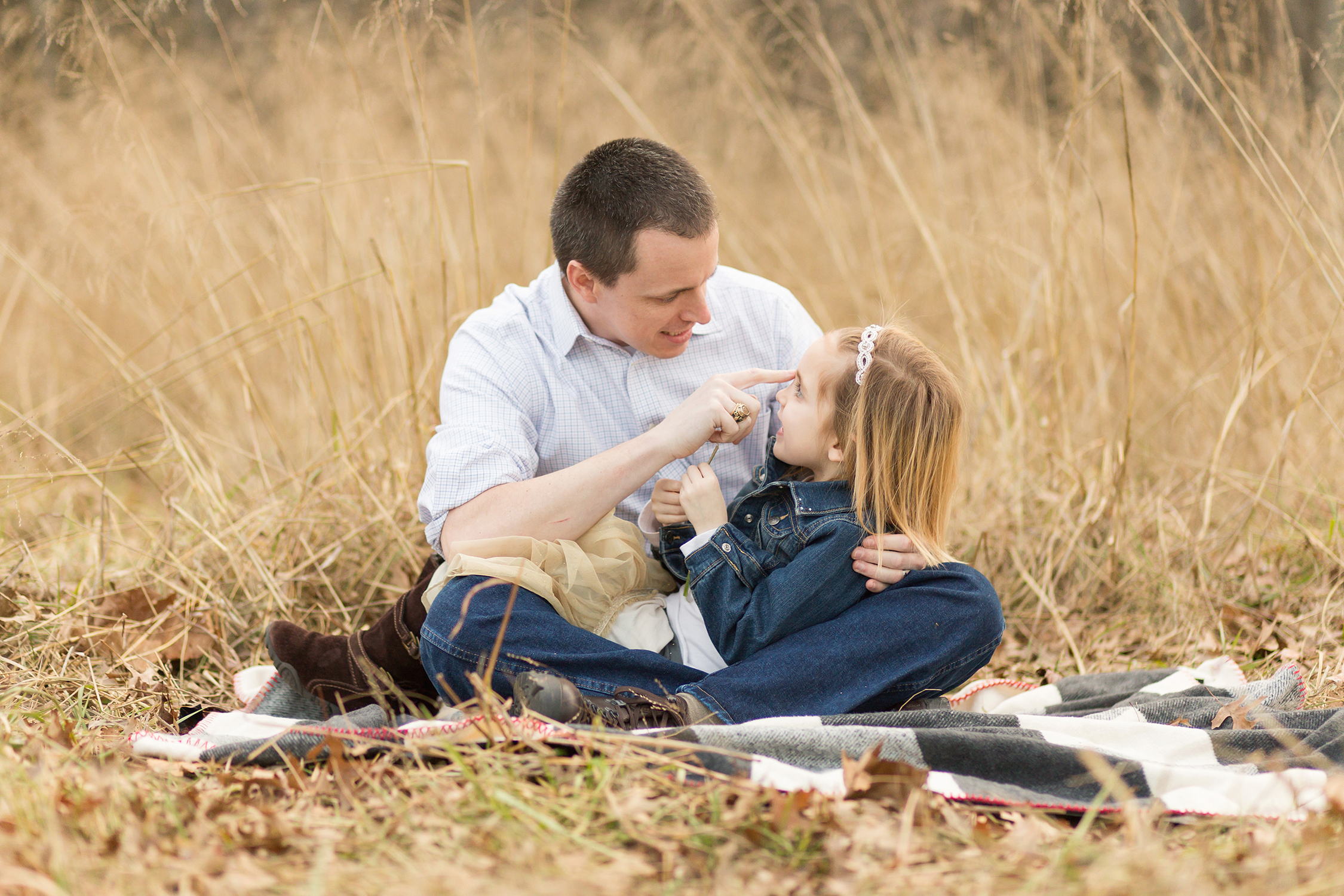 Father looking at young daughter and telling her a story | Kirkwood Kid's Photography