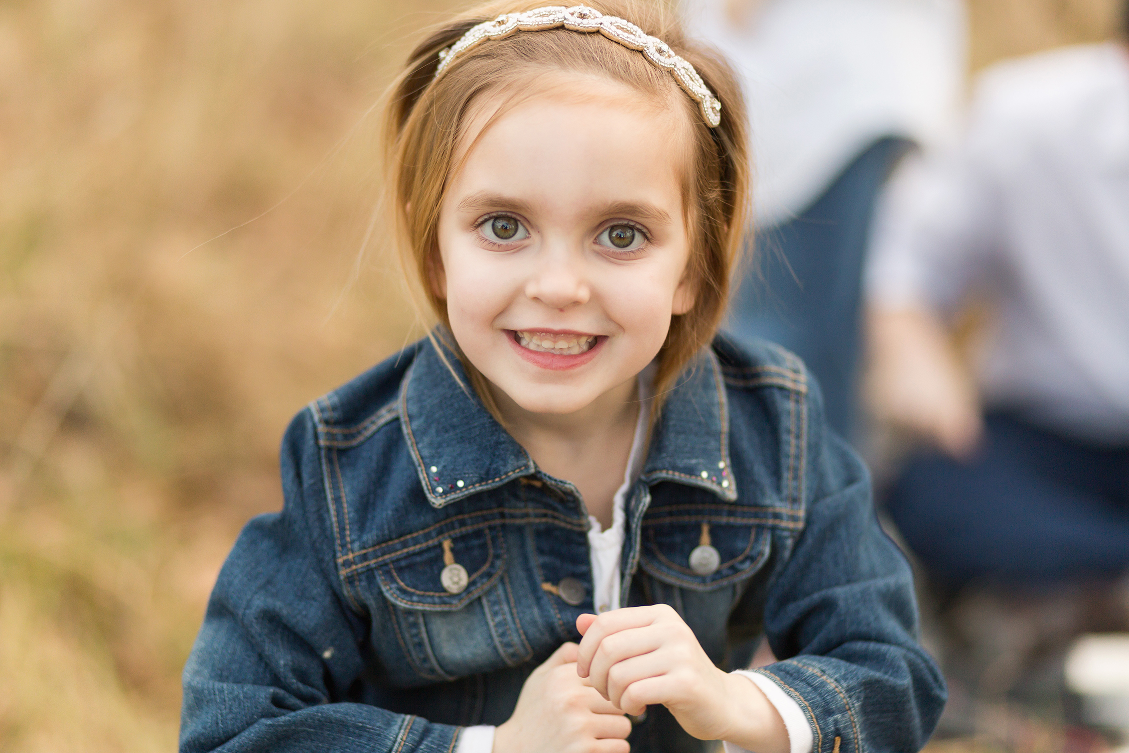 Young girl smiling looking at camera | Kirkwood Family Photographer