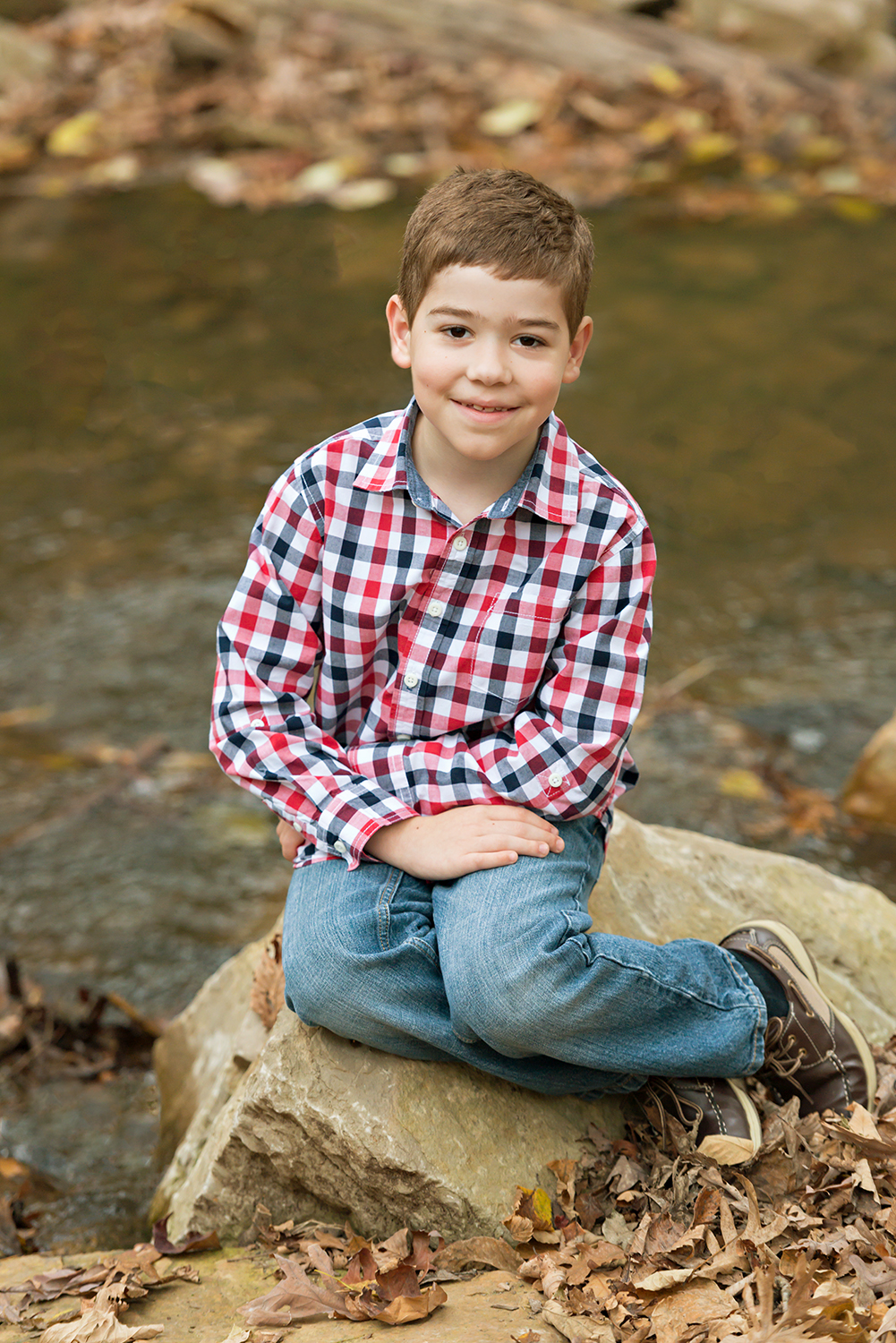 Young boy sitting on rock | St. Louis Children's Photographer