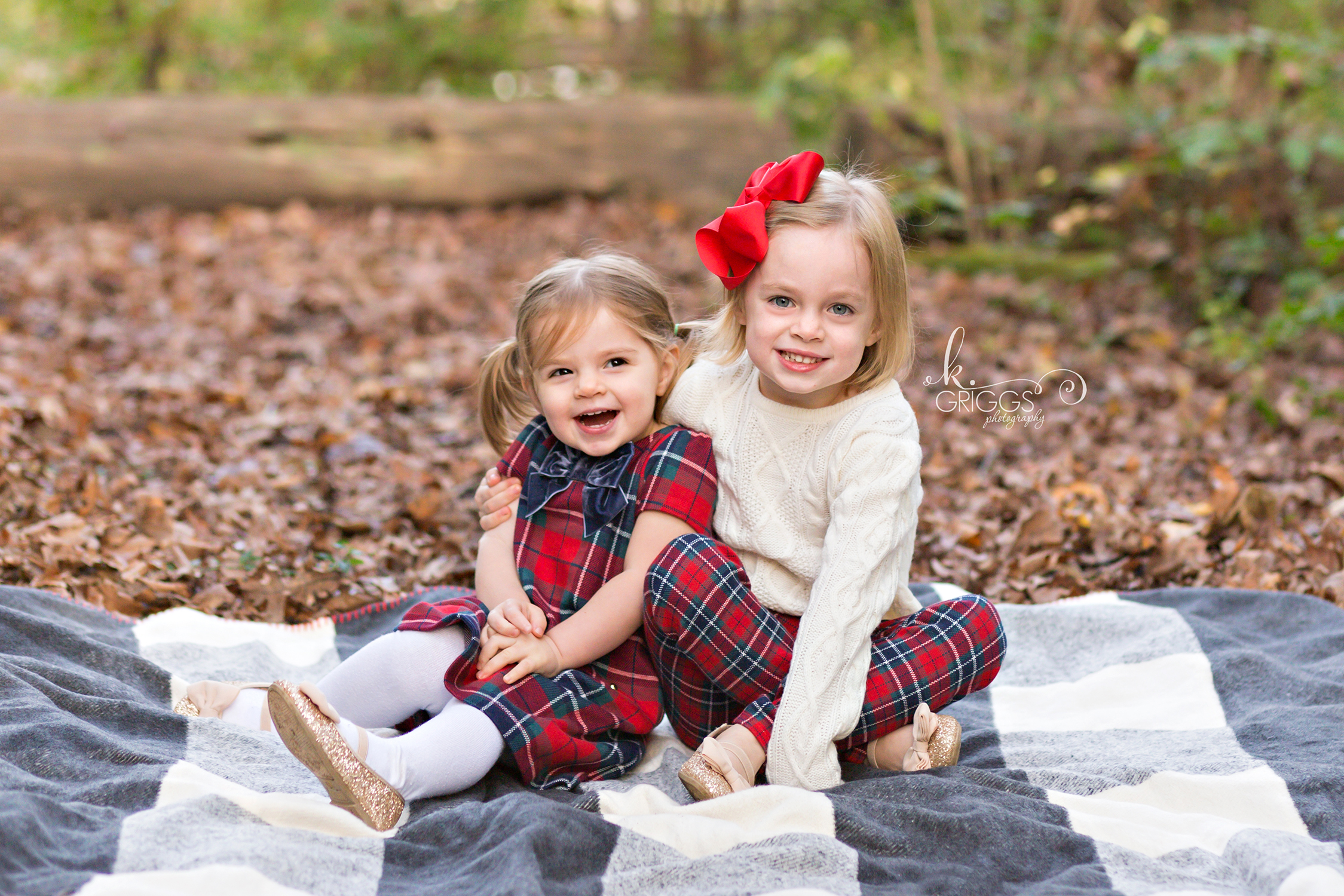 Sisters sitting on blanket smiling at camera | St. Louis Family Photography