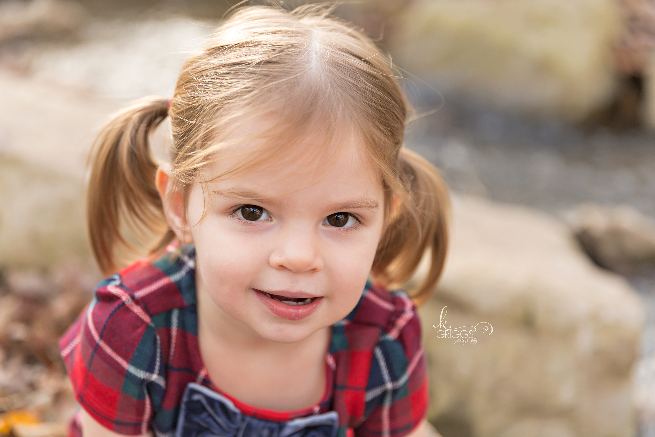 Young girl looking at camera smiling | St. Louis Photographer