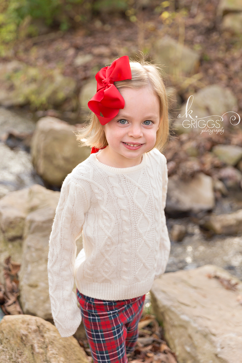 Young girl standing near creek smiling | St. Louis Kids Photographer