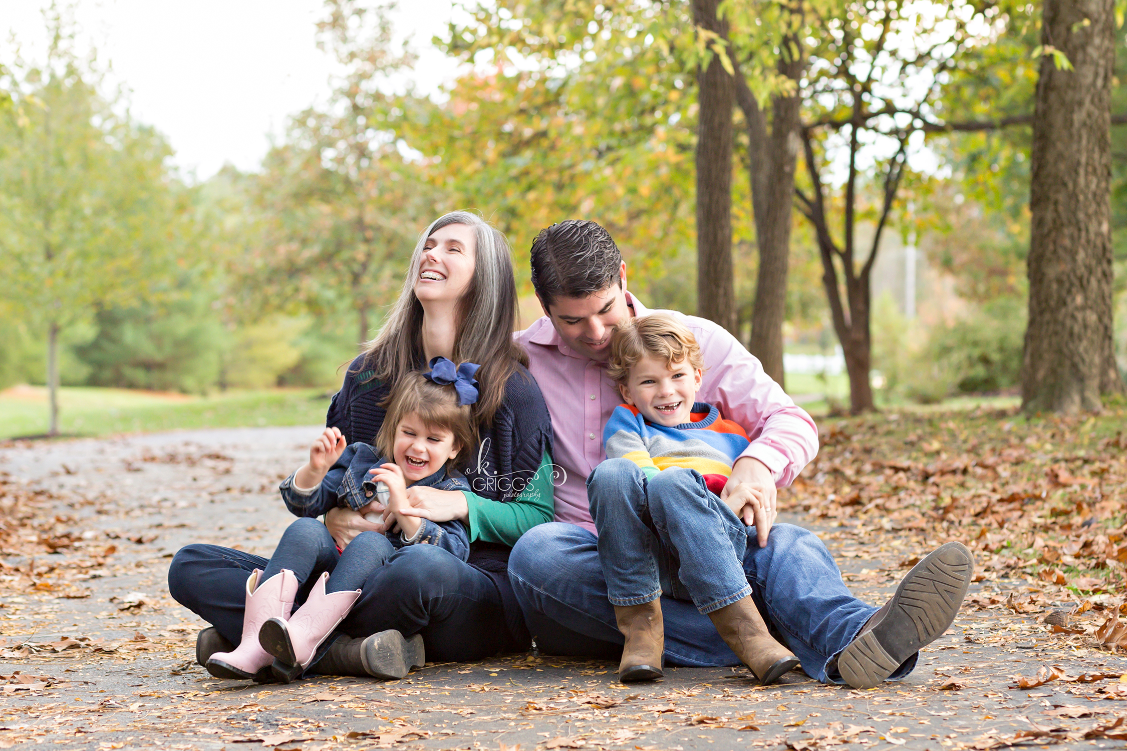 Neighbors sitting on path on fall day | St. Louis Family Photographer