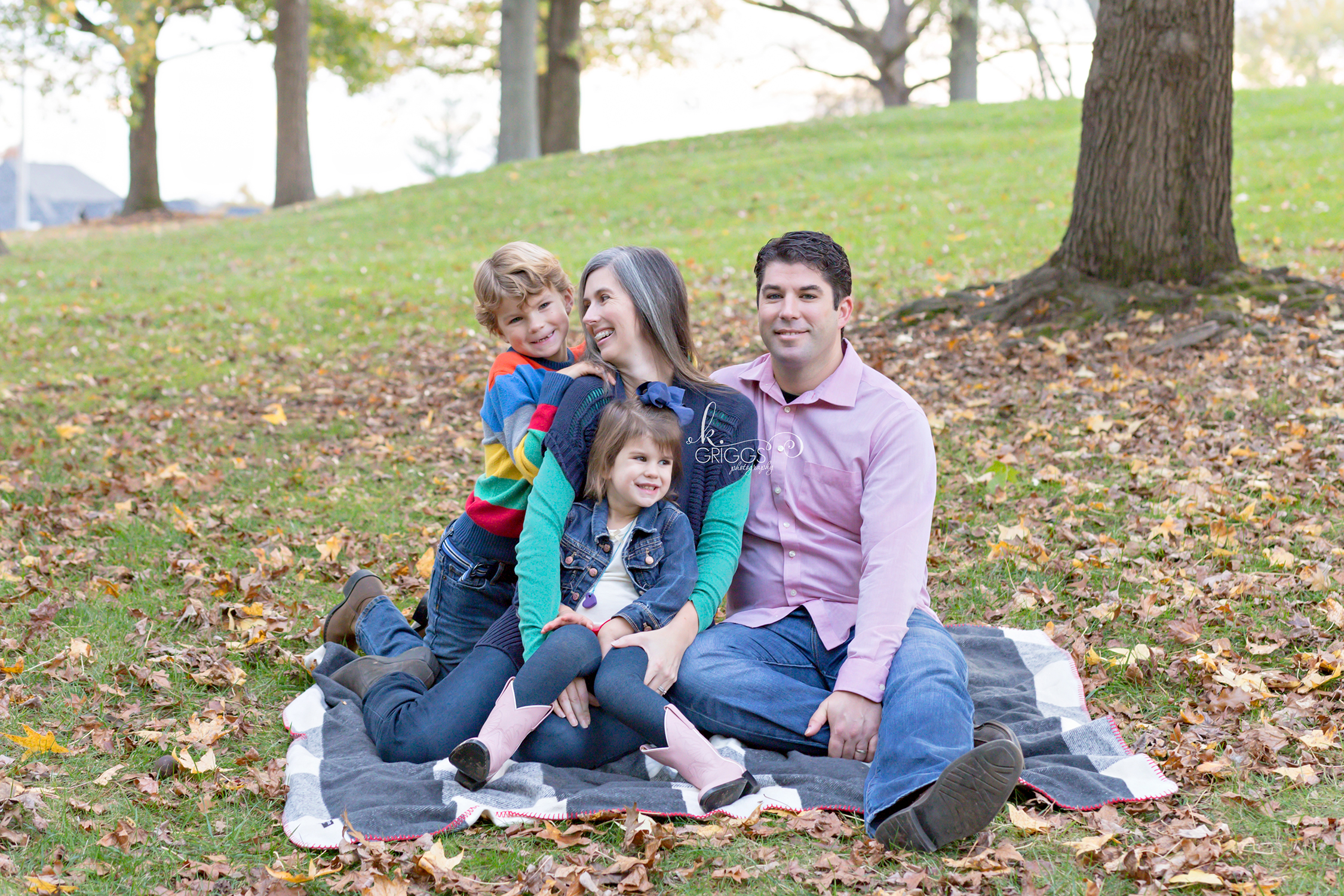 Family of 4 sitting on grass in park | Kirkwood Photographer