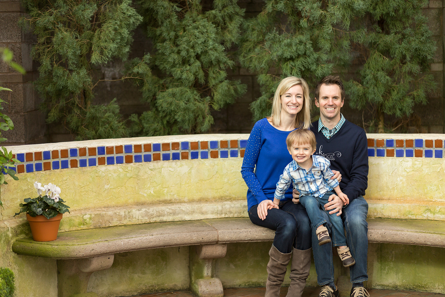 Family of 3 sitting for photo - St. Louis Photographer