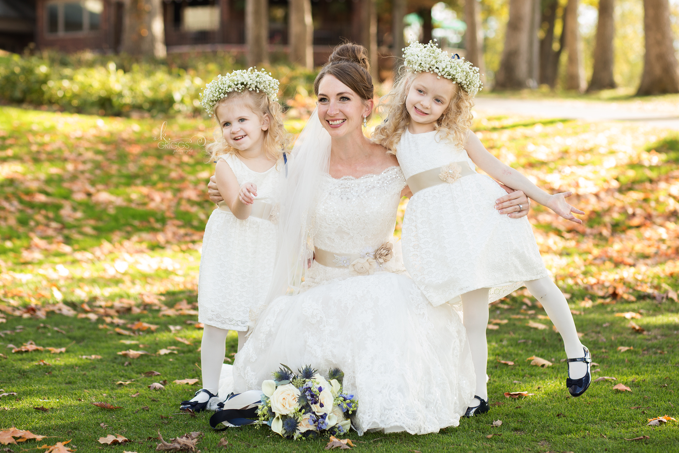 bride kneeling with her 2 flower girls | St. Louis Photographers