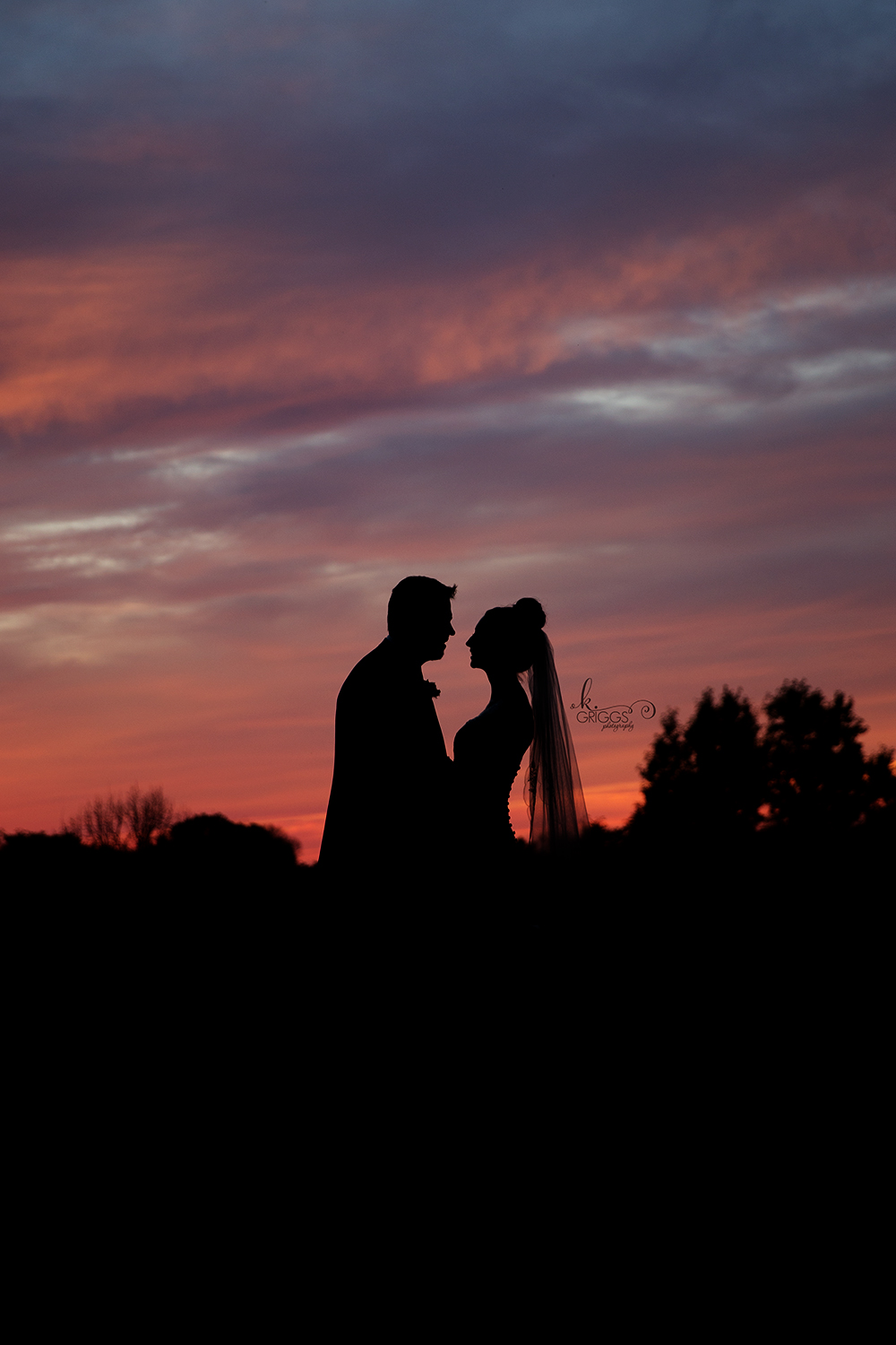 bride and groom in silhouette during sunset | St. Louis Photographer