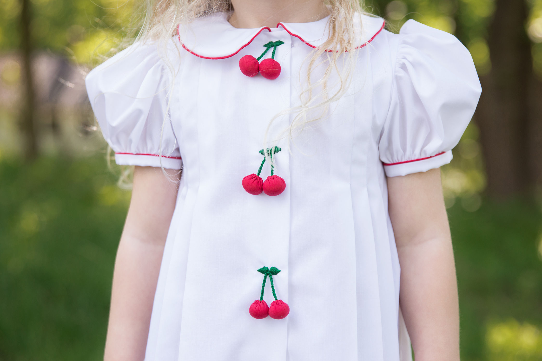 Little girl's special dress with cherries | St. Louis Family Photographer