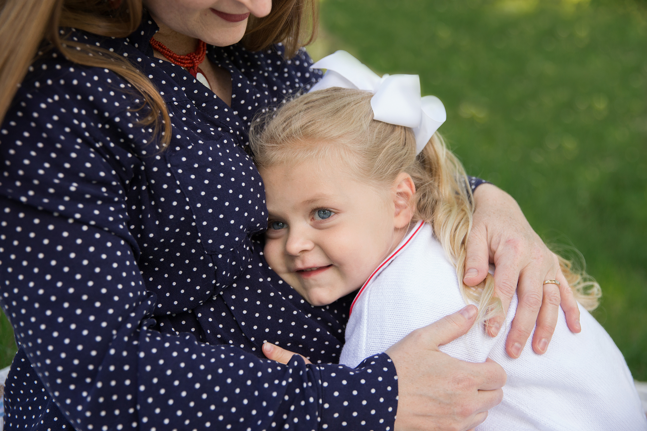 Little girl with her head on momma's tummy | St. Louis Family Photography