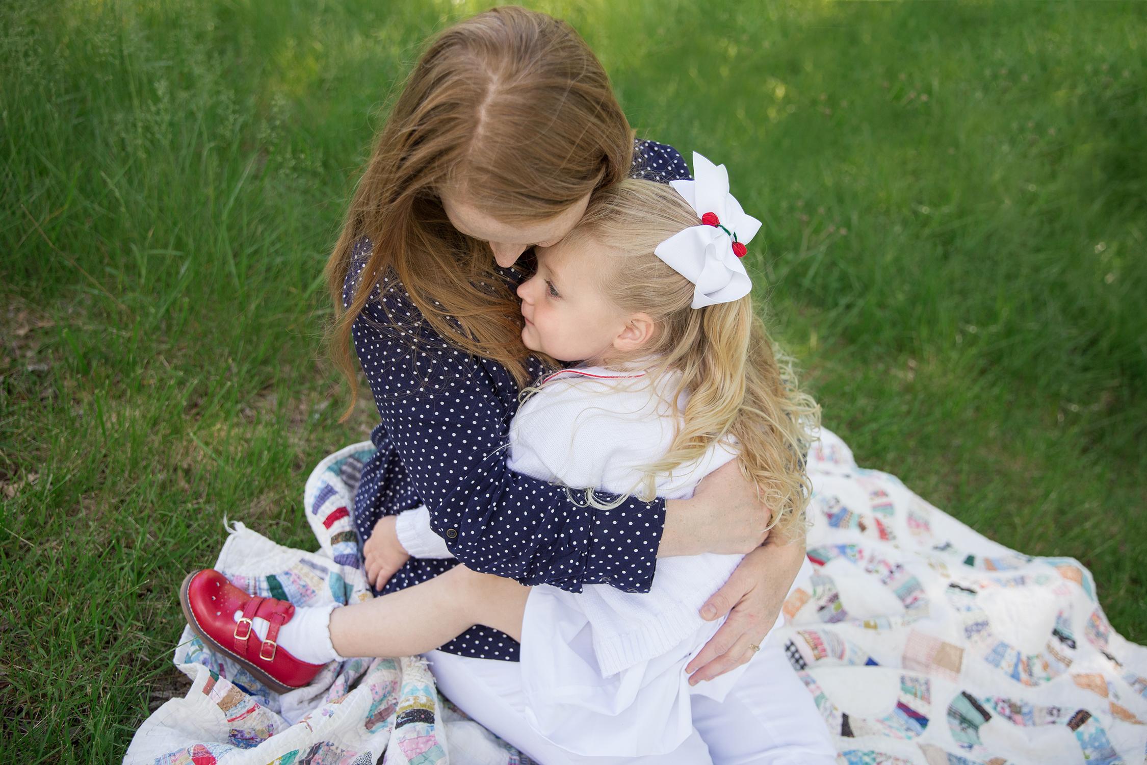 little girl sitting on her momma's lap | St. Louis Children's Photographer