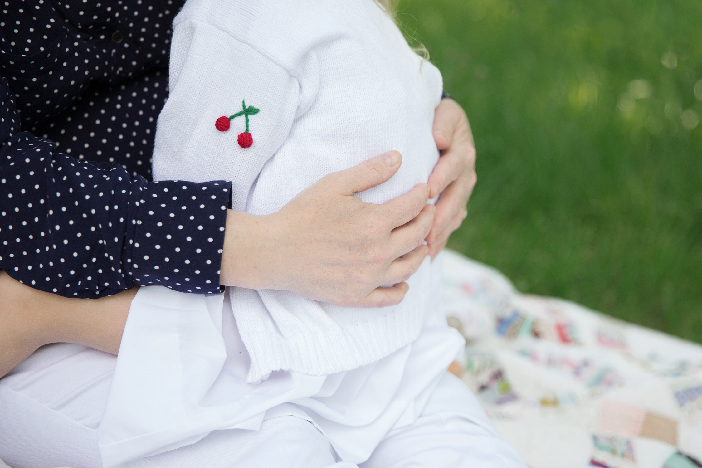 mother's hands wrapped around little girl | St. Louis Family Photographer