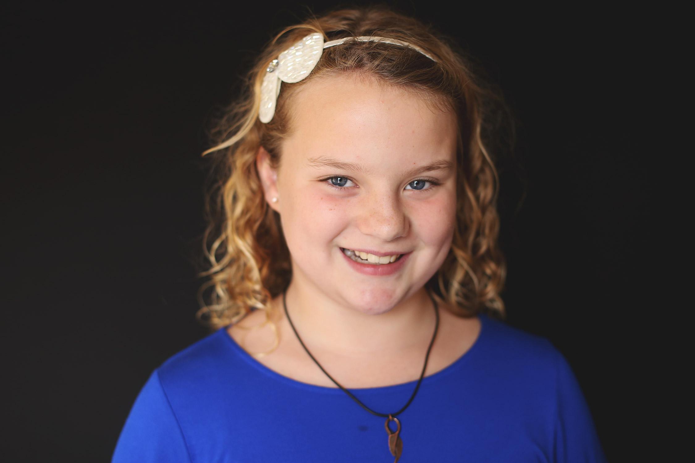 Tween girl smiling at camera   St. Louis School Pictures