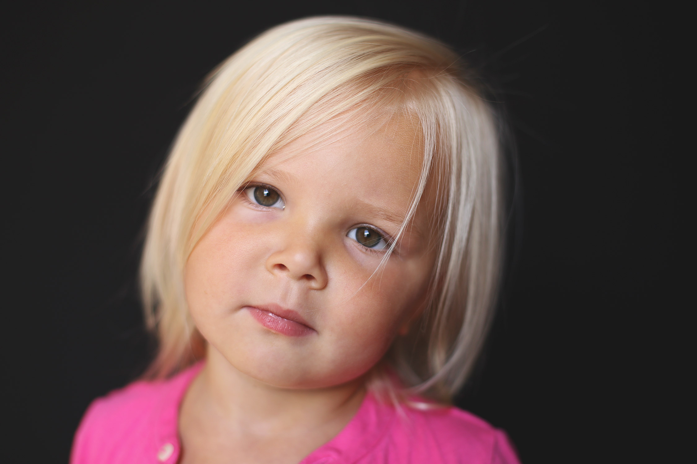 Blonde haired toddler girl looking at camera   St. Louis School Photos