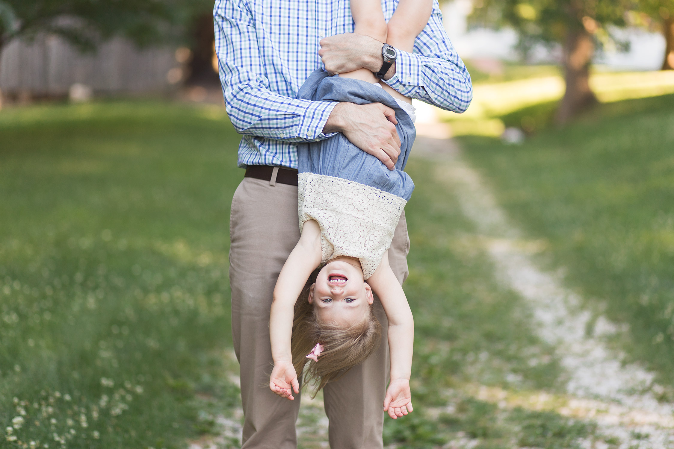 Daddy holding daughter upside down in Faust Park | St. Louis Family Photos