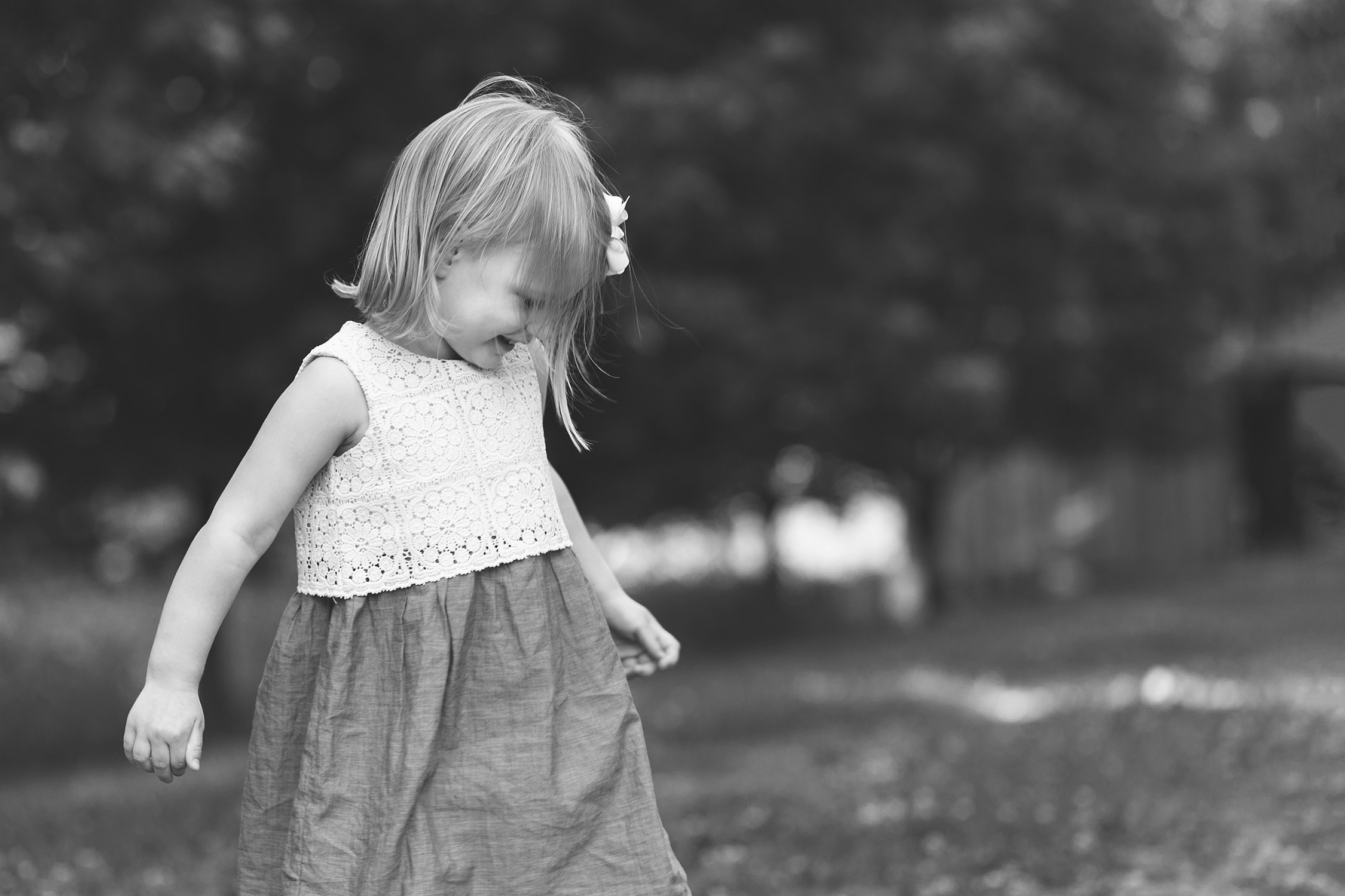 Little girl twirling in her dress in Faust Park | St. Louis Photographer