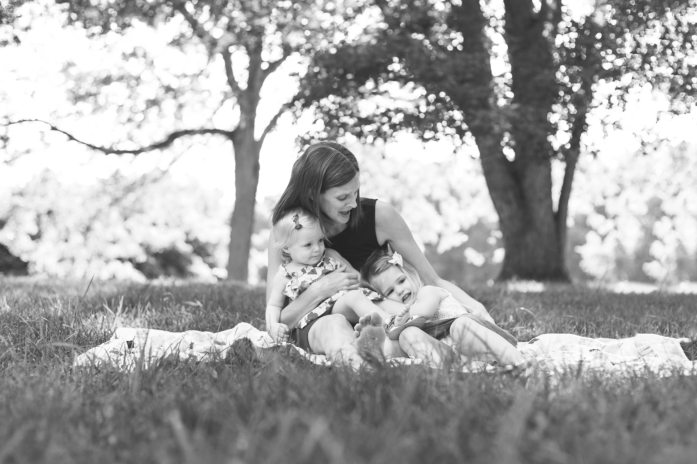 Mommy singing to her two little girls in Faust Park | St. Louis Photography