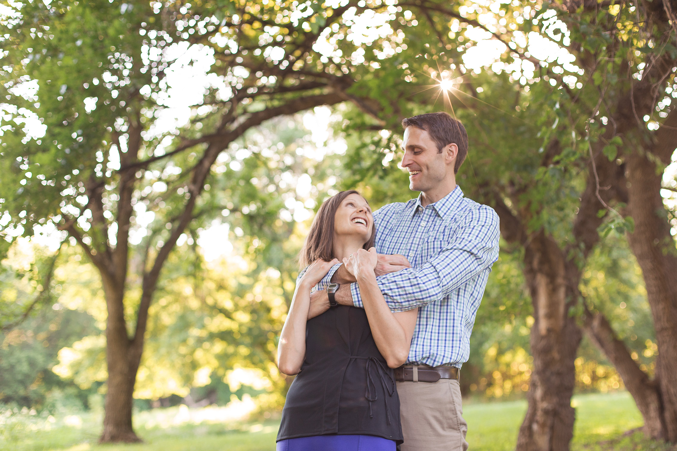 Husband and wife looking at each other in Faust Park | St. Louis Family Photographer