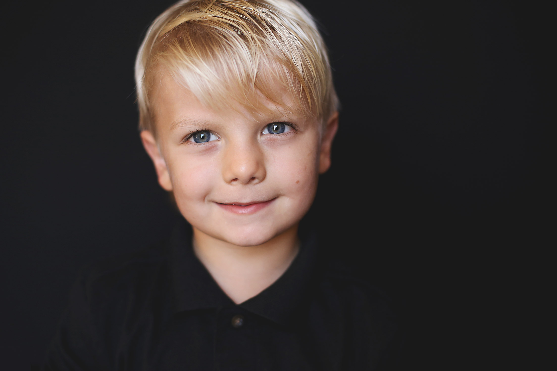 Blonde haired young boy smiling at camera   St. Louis School Photography